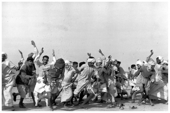 henri cartier bresson refugees performing exercises kurukshetra india 1947 660x441 Timeless Insights You Can Learn From the History of Street Photography