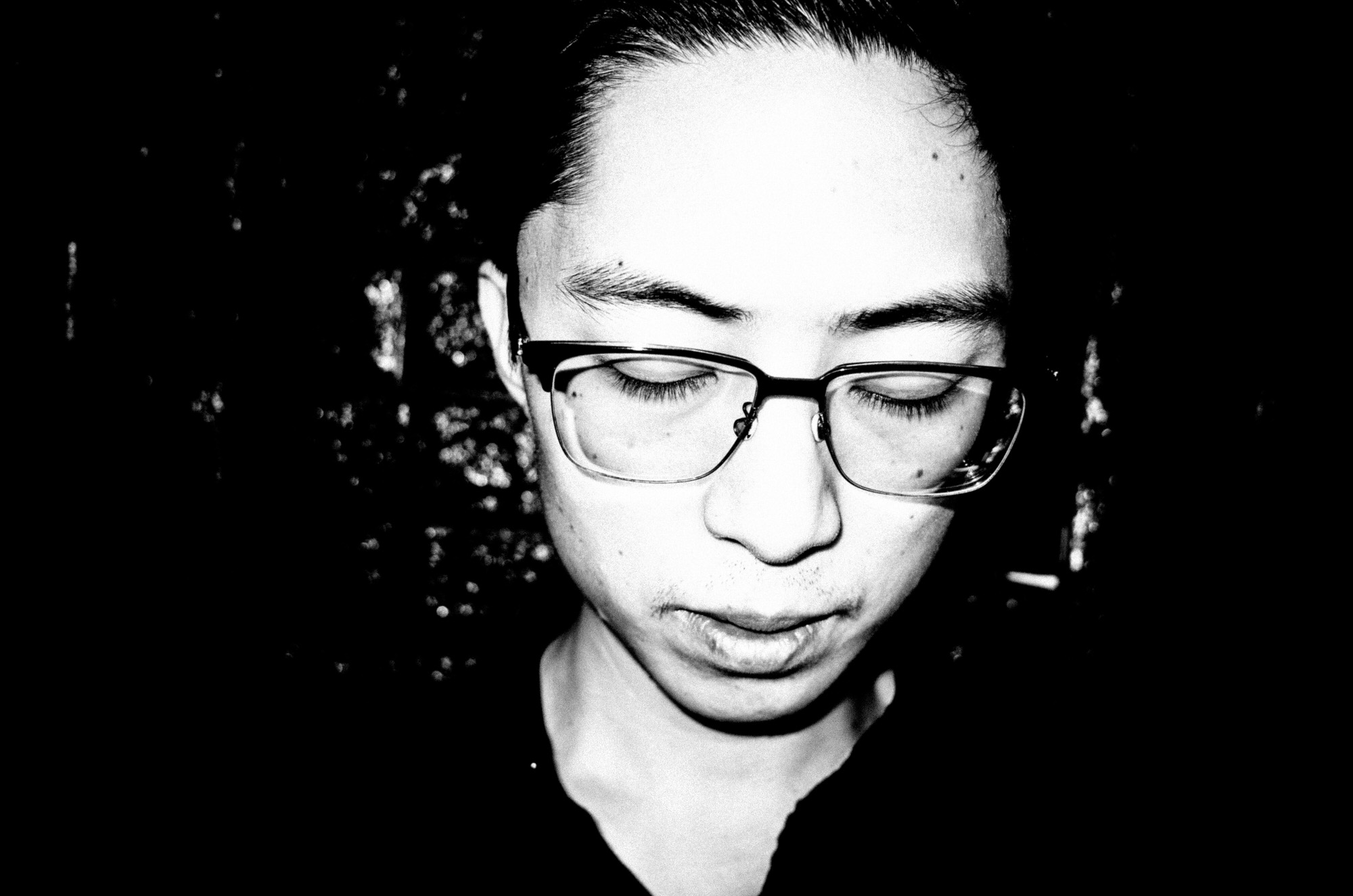 eric kim photography black and white hanoi-0009770-self portrait - looking down